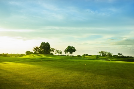 A beautiful golf course in the Philippines during sunset photo