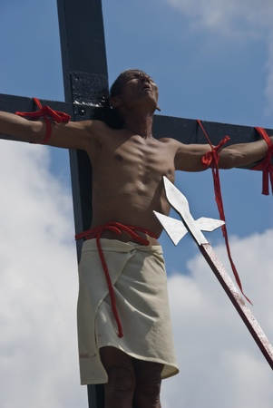 crucis: Participant in the Senakulo in Cutud, San Fernando, Pampanga in the Philippines where they dramatize the Passion of Jesus Christ.  The event is highlighted by live crucifixions of men. This is an annual Holy Week ritual in Barangay Cutud, San Fernando, Pa