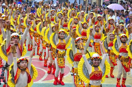 feast day: CAPALONGA, BICOL, PHILIPPINES - MAY 12: Unidentified dancers perform during the annual celebration of the towns feast day on May 12, 2009 in Capalonga, Bicol, Philippines.  Editorial