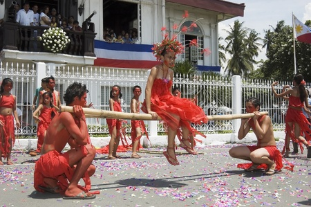 proclaimed: KAWIT, CAVITE, PHILIPPINES - JUNE 12: Unidentified male and female dancers perform during the celebration of the independence of the Philippines on June 12, 2006 in Kawit, Cavite, Philippines.  The countrys independence was originally proclaimed in Kawit