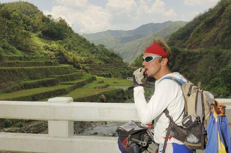 HALSEMA, IFUGAO, PHILIPPINES - APRIL 3: Unidentified mountain biker takes a break on APRIL 3, 2007 along Halsema, Ifugao Province, Philippines during a