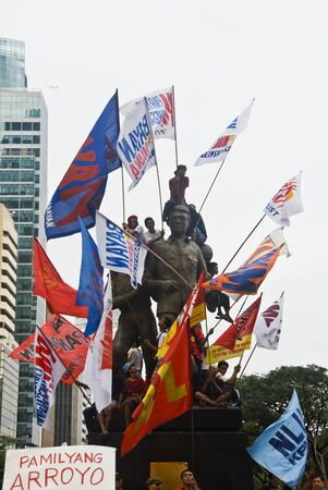 gloria: Thousands of Filipinos from different sectors trooped to Makati City, the countrys central business district, and demanded the resignation of President Gloria Macapagal Arroyo following the revelations of star witness Jun Lozada about alledged kickbacks  Editorial