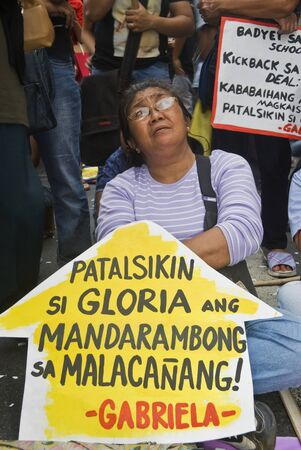 arroyo: Thousands of Filipinos from different sectors trooped to Makati City, the countrys central business district, and demanded the resignation of President Gloria Macapagal Arroyo following the revelations of star witness Jun Lozada about alledged kickbacks  Editorial