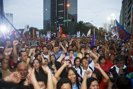 Thousands of Filipinos from different sectors trooped to Makati City, the country's central business district, and demanded the resignation of President Gloria Macapagal Arroyo following the revelations of star witness Jun Lozada about alledged kickbacks  Editorial