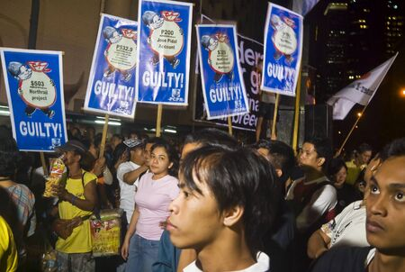 misconduct: Thousands of Filipinos from different sectors trooped to Makati City, the countrys central business district, and demanded the resignation of President Gloria Macapagal Arroyo following the revelations of star witness Jun Lozada about alledged kickbacks  Editorial