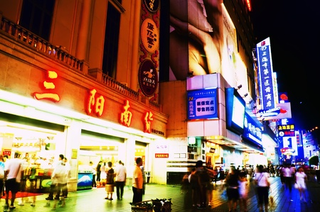 SHANGHAI - AUGUST 19, 2009: Nanjing Road on August 19, 2009 in Shanghai.  Thousands of foreign and local tourists stroll nightly under bright neon signs on Nanjing Road, Shanghai. Editorial