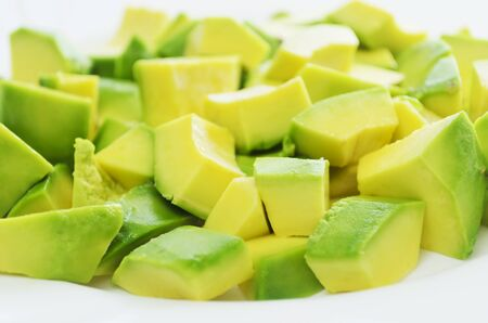 cubed: Close-up of cubed ripe avocado fruit on white plate Stock Photo