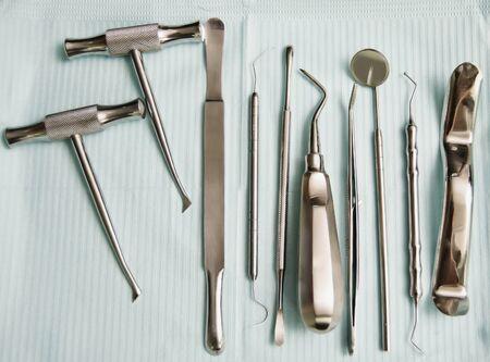 Various dental instruments on top of bib