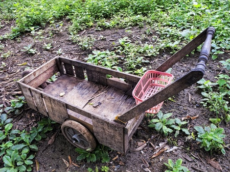 Makeshift wooden cart from junk parts. photo