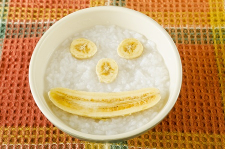 baby rice: Baby food composed of rice porridge and bananas Stock Photo