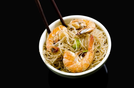 Pancit Bihon, a Filipino noodle dish, on black background
