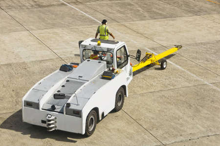 Airport personnel ground support on tarmac in their truck
