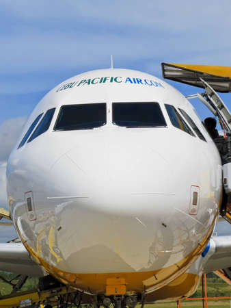 Gensan, Philippines - April 2, 2011: Passengers board a Cebu Pacific airplane bound for Manila. Stock Photo - 12679383
