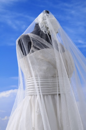 White wedding gown shot gainst blue sky Stock Photo - 13419196