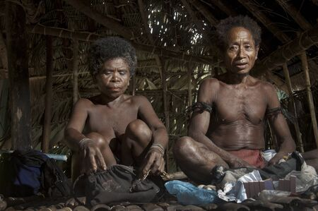 locals: Old Agta couple inside their makeshift hut in Sierra Madre, Philippines