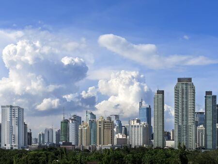 Makati skyline shot against blue sky and swirling clouds photo