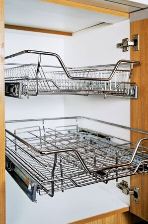 Open Kitchen Cabinet With Two Layers Of Stainless Dish Rack Stock