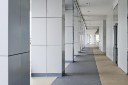 passageway: Passageway leading to a multi-level building parking lot. Stock Photo