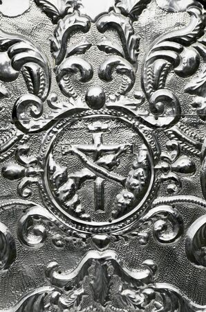 hammered: Detail of an old hammered aluminum religious art  Stock Photo