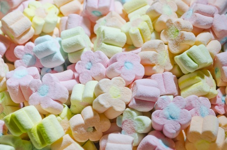 Multicolor flower-shaped marshmallows served at a childrens party