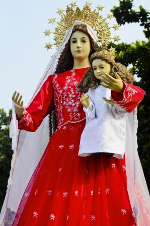 Statue of the Holy Mother Virgin Mary carrying the Child Jesus. Stock Photo