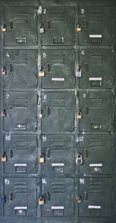 Old, rusty school locker with labels and padlocks