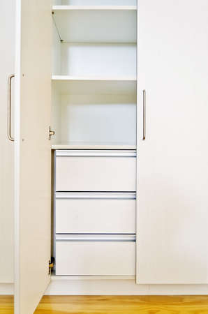 unoccupied: Built-in cabinet in room of an unoccupied newly-built apartment.