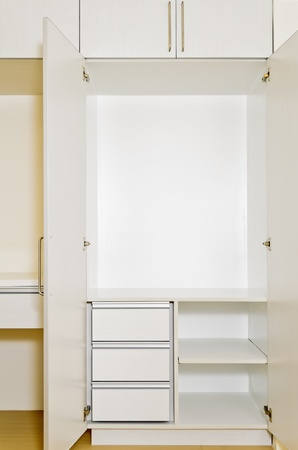 Built-in cabinet in room of an unoccupied newly-built apartment