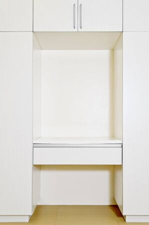 Built-in cabinet in room of an unoccupied newly-built apartment  Editorial