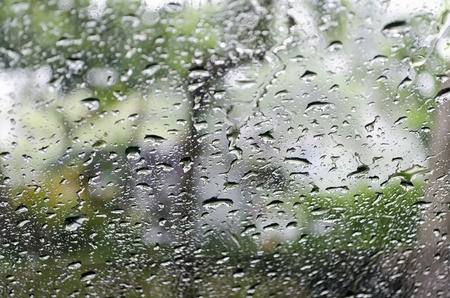 Rain drops on automobile windshielld photo
