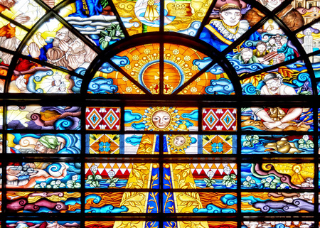 glasswork: Stained glass inside the famous Our Lady of Penafrancia in the Philippines Stock Photo