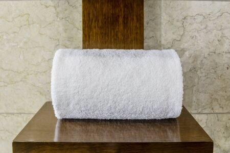 white towels: White cotton hotel towels on wooden cross