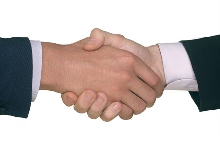 Closeup of hands of two males shaking hands