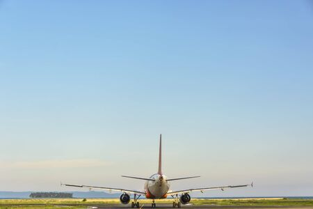 carbon emission: Commercial plane starts taxiing in a provincial airport Stock Photo