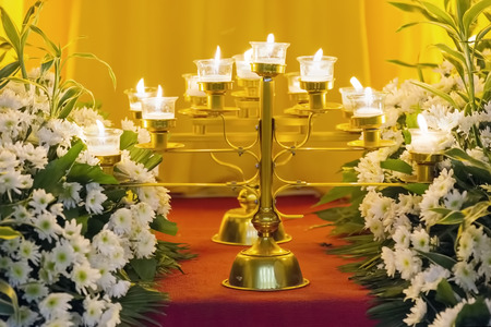 Flowers and burning candles at Altar of Repose
