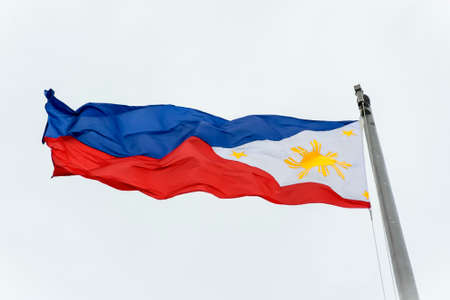 wind blown: Full shot of wind blown flag of the Philippines Stock Photo