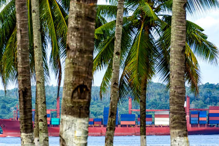 thru: Container cargo ship passing thru canal, Philippines