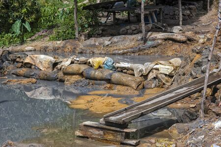 residue: Dump and slurry of small time gold miners Stock Photo