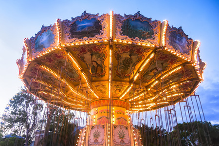 Merry-go-round in an amusement park Stock Photo