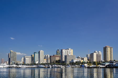 Manila Bay cityscape and yachts in water 写真素材