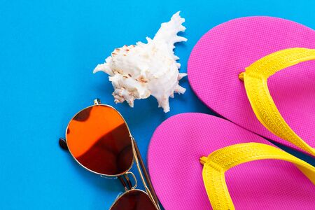 shoes,shellfish,Sunglasses on a blue background and Summer travel ideas Stok Fotoğraf - 132614351