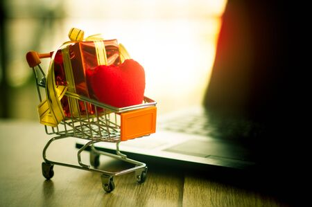 Online shopping concept - trolley cart full of presents. Reklamní fotografie