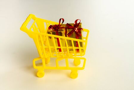 Online shopping concept - trolley cart full of presents. Black Friday and Ciber Mondey. Reklamní fotografie