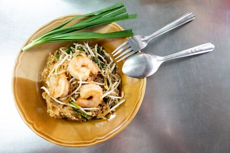 Rice noodles with shrimps and vegetables close-up on the table. top view of a horizontal Zdjęcie Seryjne