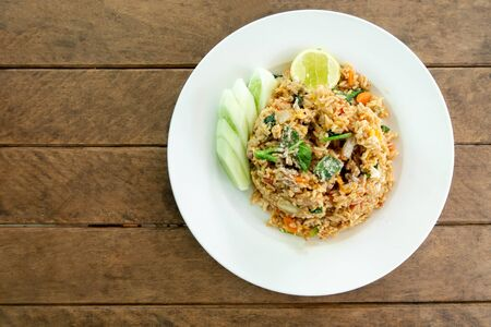 Fried rice chicken egg and vegetable carrot chinese kale green onion and cucumber on plate - thai food Zdjęcie Seryjne