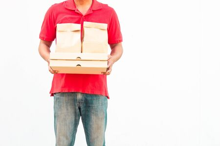 Holding various take-out food containers, pizza box, in holder and paper bag, close-up. Light grey background, place to insert your text. Delivery man. Zdjęcie Seryjne
