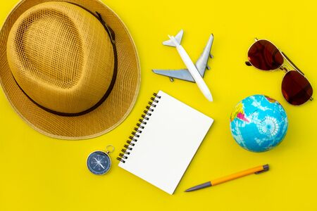 Flat lay traveler accessories on yellow background with blank space for text. Top view travel or vacation concept. Summer background. Zdjęcie Seryjne