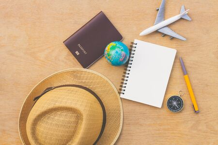 Flat lay traveler accessories on wood background with blank space for text. Top view travel or vacation concept. Summer background. Zdjęcie Seryjne