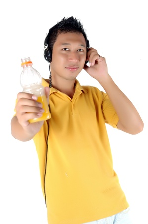 brandishing: young man listening to music while brandishing his drink bottle, isolated on white Stock Photo