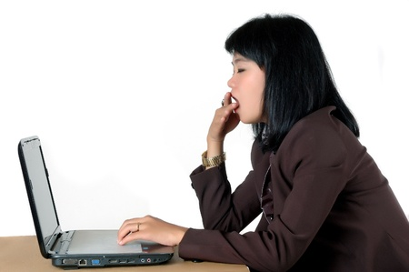 drowsiness: asian young secretarys office  yawning  in his office isolated on white